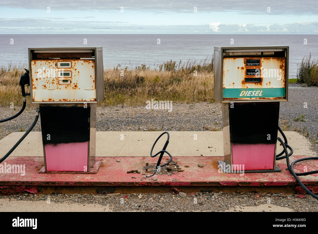 Old dirty gas stations, symbolizing the end of fossil energy - Stock Image