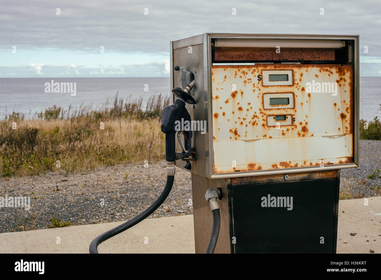 Old dirty gas station, symbolizing the end of fossil energy - Stock Image
