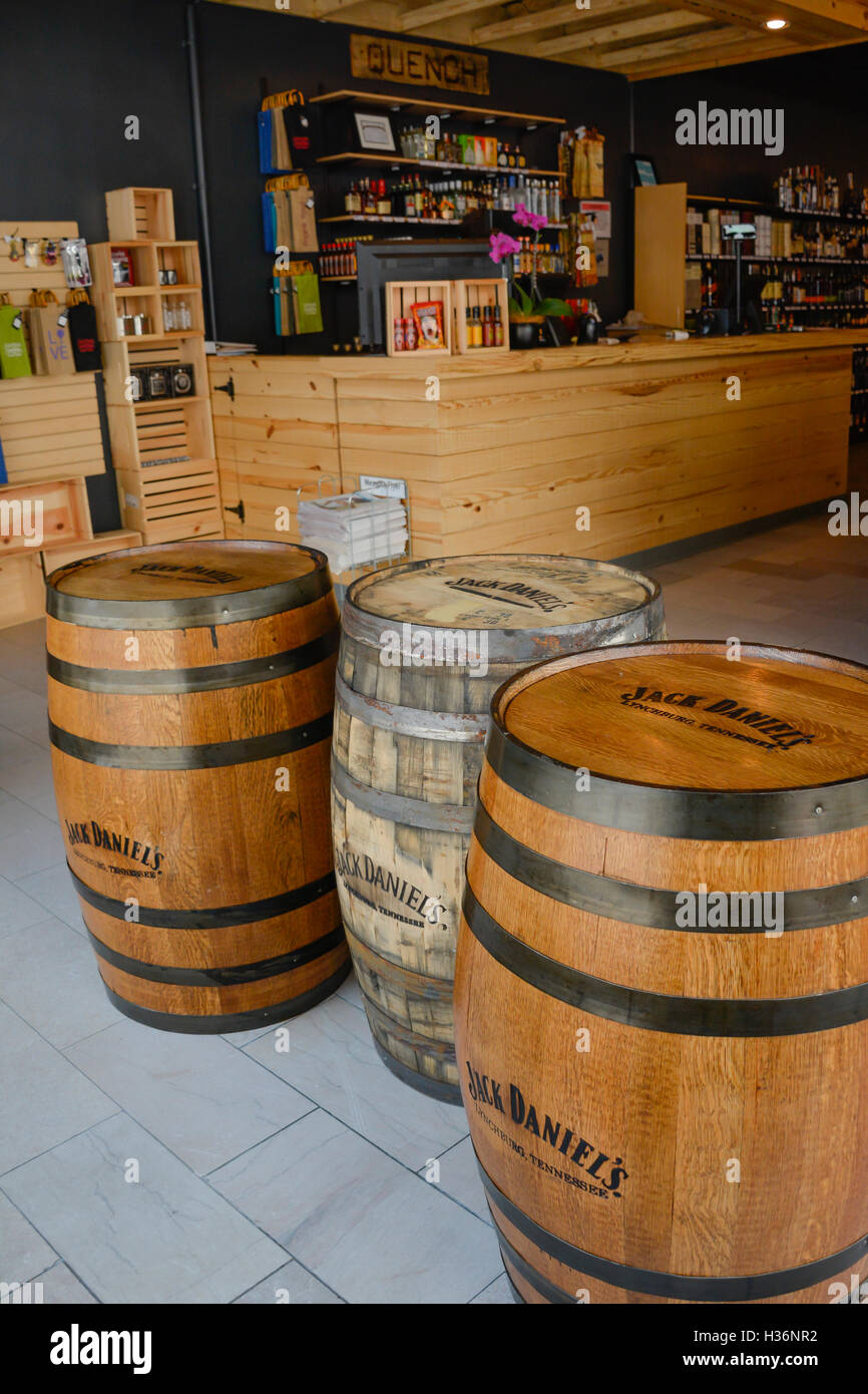 The Interior of the Quench Wine & Spirits store with wooden design elements & Jack Daniel's oak barrels - Stock Image