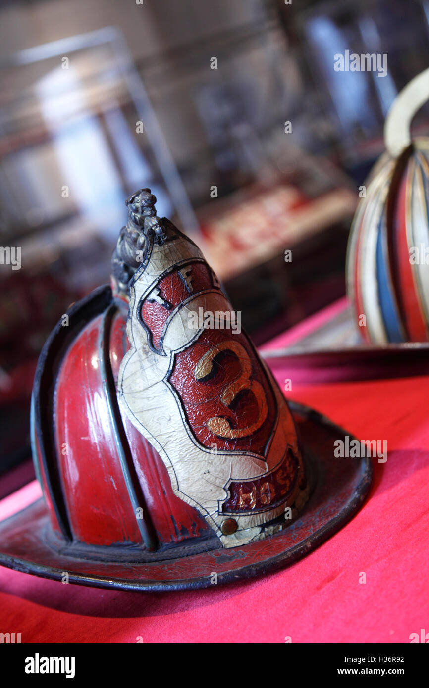 Old leather fire helmets display in New York City Fire Museum. New York City. New York. USA - Stock Image