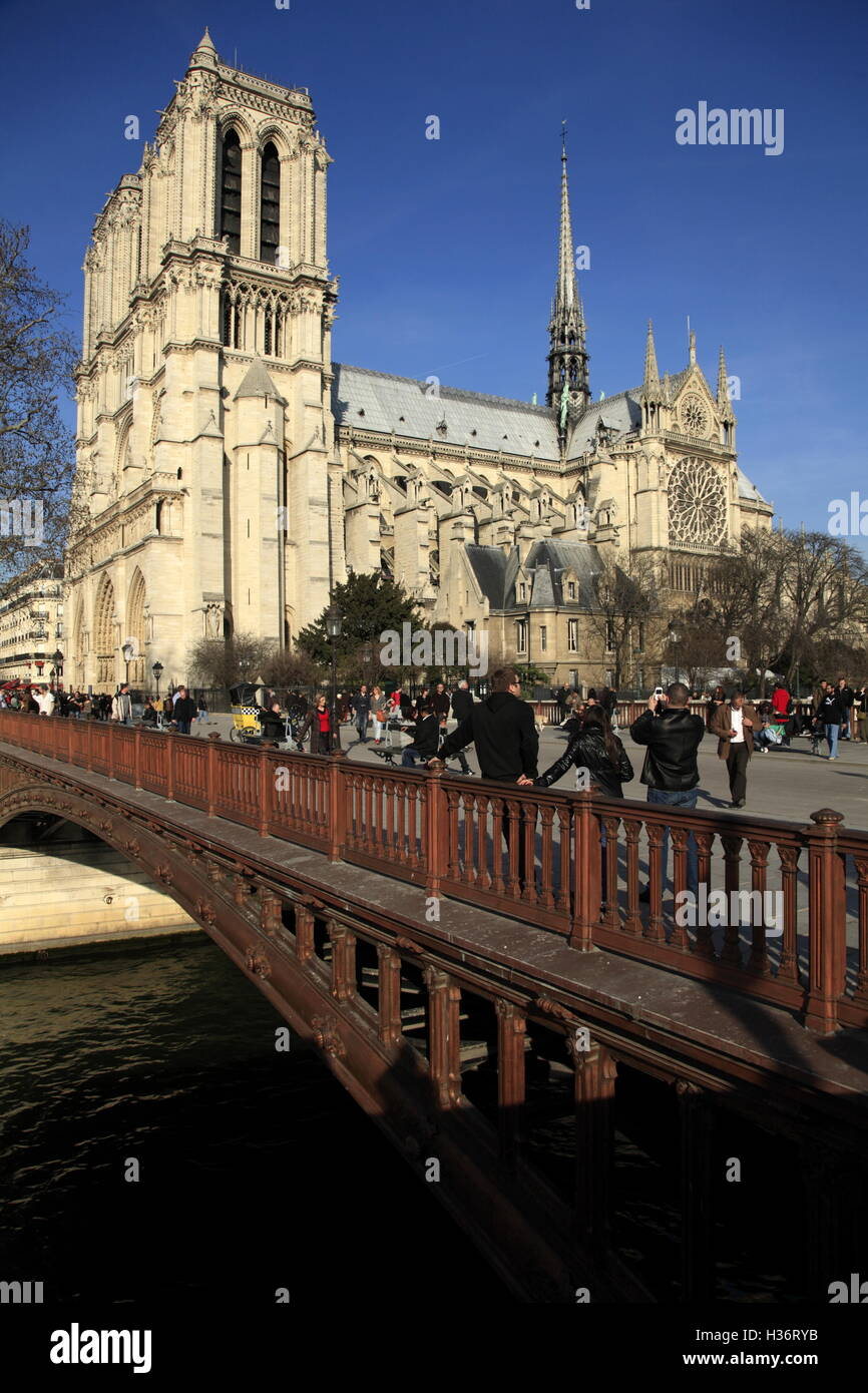 The cast-iron Pont au Double (The bridge of double) cross River Seine with Notre Dame Cathedral in the background. - Stock Image