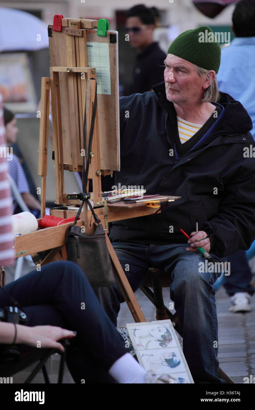 An artist sketching a young girl in Place du Tertre square.Montmartre.Paris.France Stock Photo