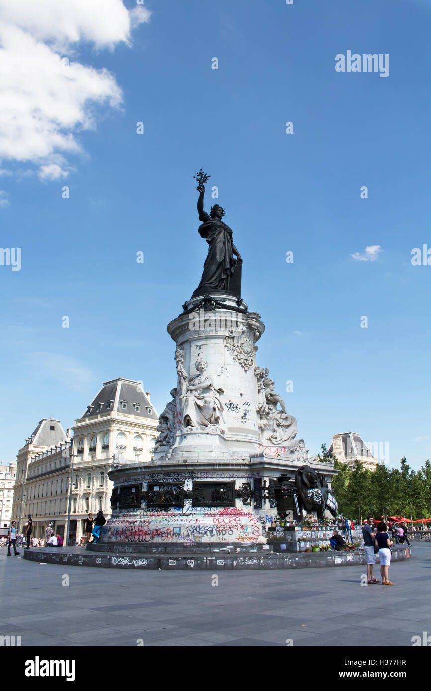 View of statue Andre Tollet at republic square in Paris. People hang out around it. Stock Photo