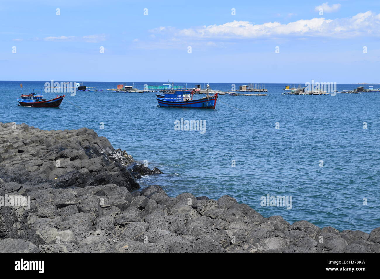 Vietnamese natural heritage Ganh Da Dia sea with fishing boats in Tuy Hoa, Phu Yen - Stock Image