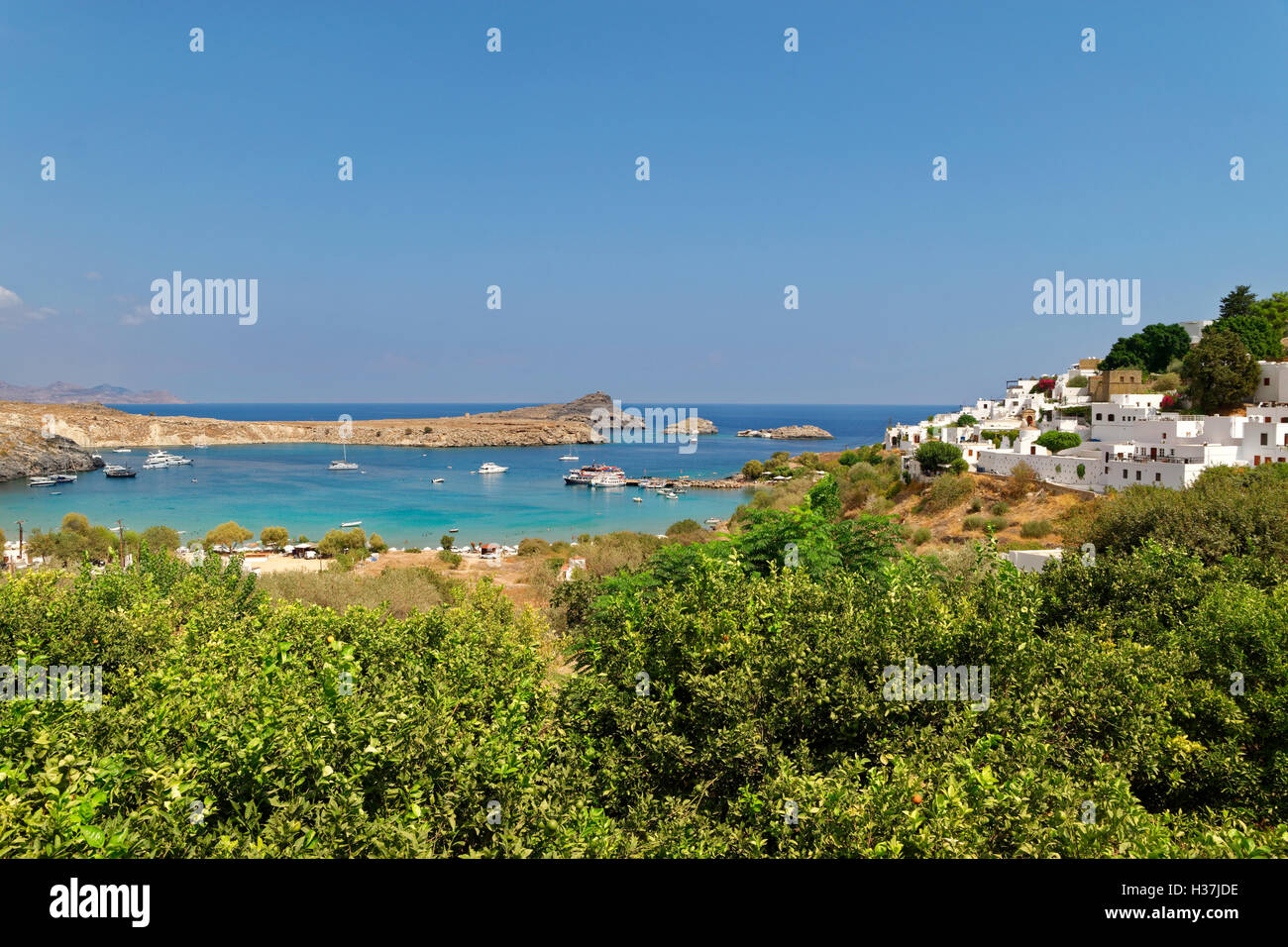 Village of Lindos and beach on the south east coast of Rhodes Island, Dodecanese Island group, Greece. - Stock Image
