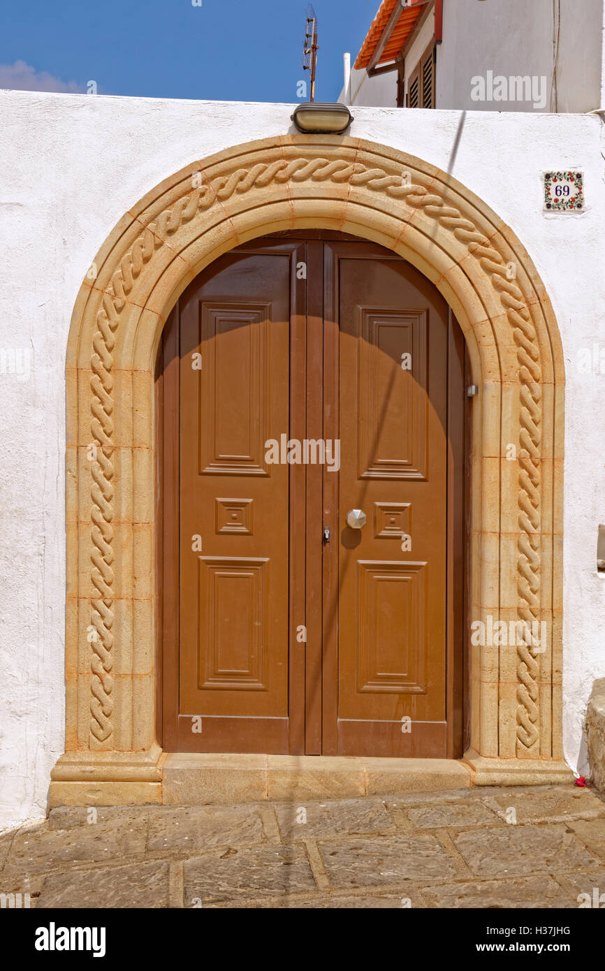 Doorway in the village of Lindos, Island of Rhodes, Dodecanese Islands Group, Greece. - Stock Image