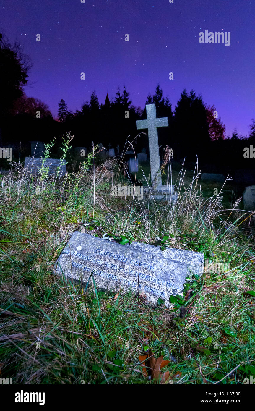 The overgrown grave of Clifford Coffin, at Holy Trinity Church, Coleman's Hatch, East Sussex. - Stock Image