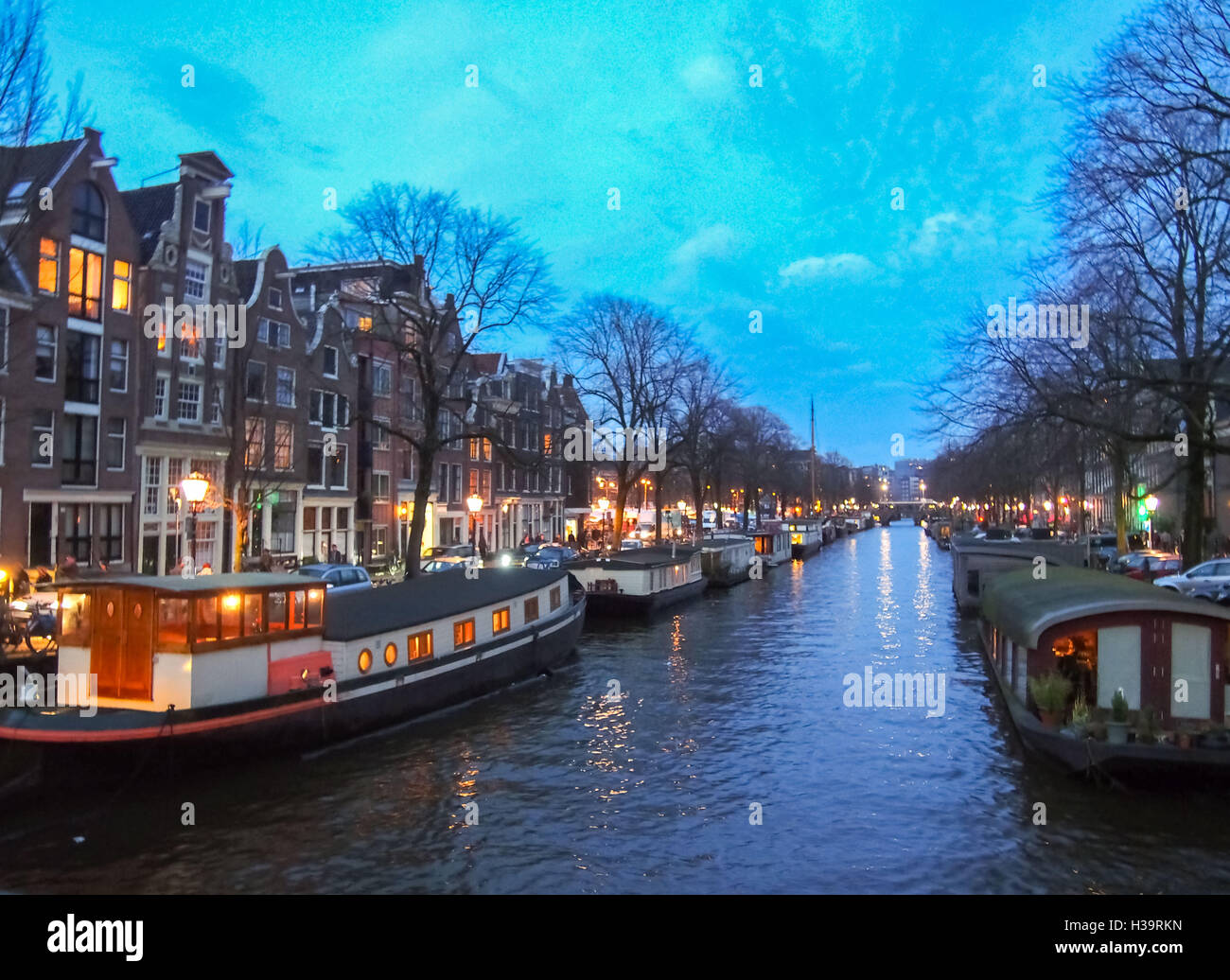 View of a canal in Amsterdam at twilight during winter - Stock Image