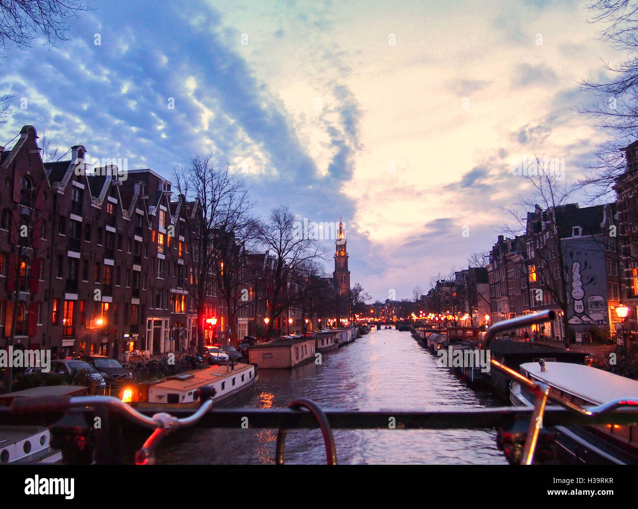 View of a canal from the bridge in Amsterdam at twilight during winter Stock Photo