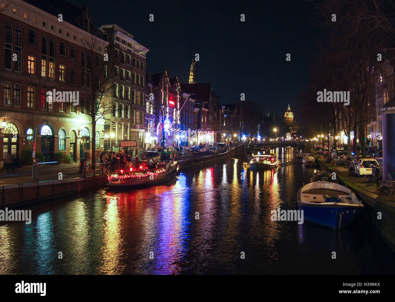 View of a canal in Amsterdam by night during winter - Stock Image