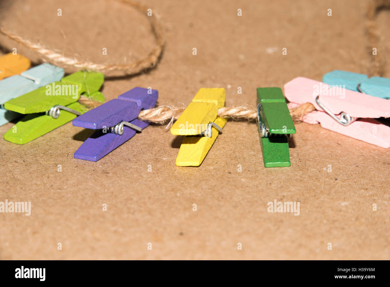 Colorful wooden clothespin. Background of colorful clothes pegs. Closeup of colorful clothespins. Stock Photo
