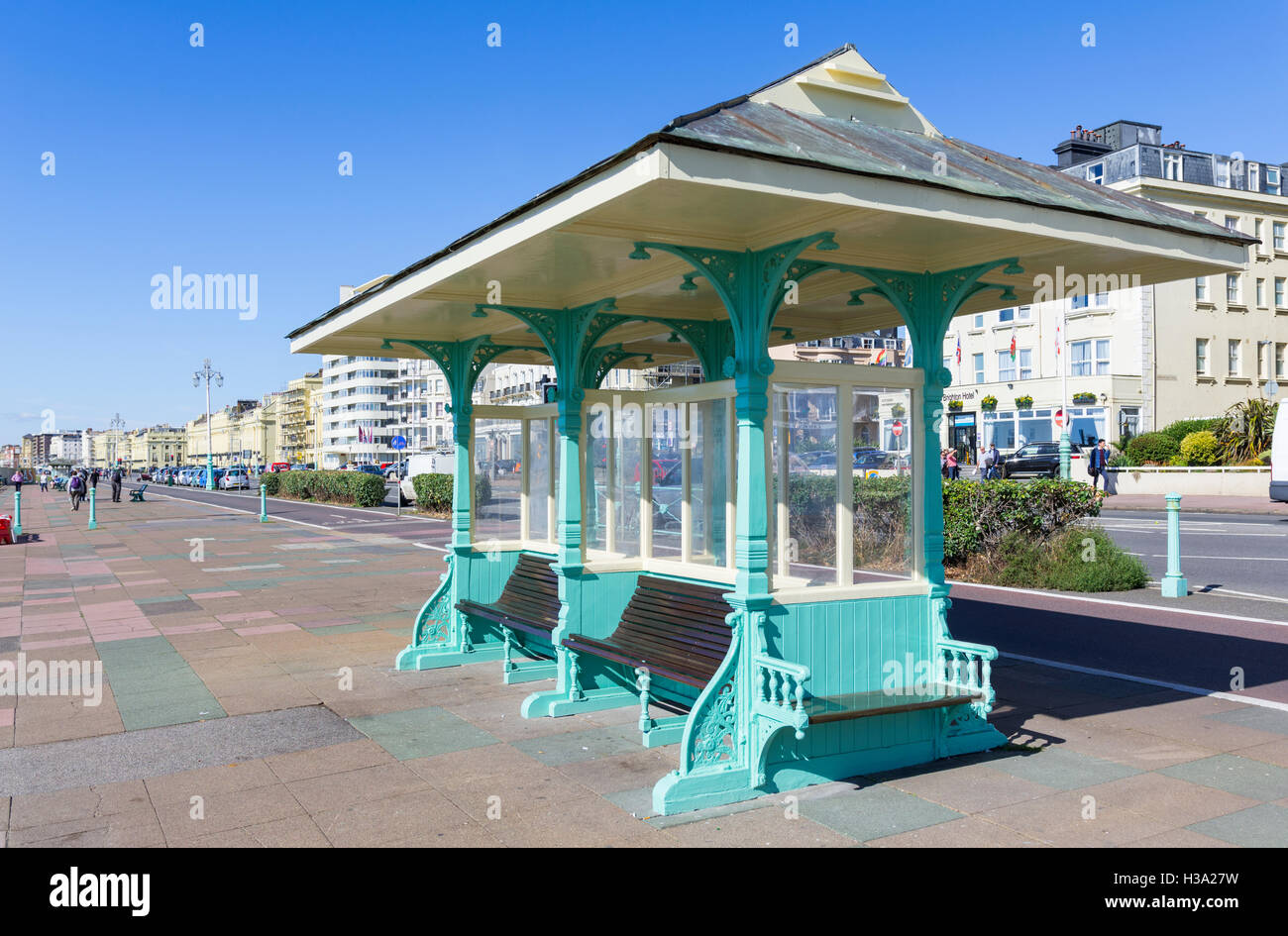 Old style seafront shelter on the promenade at Brighton, East Sussex, England, UK. - Stock Image