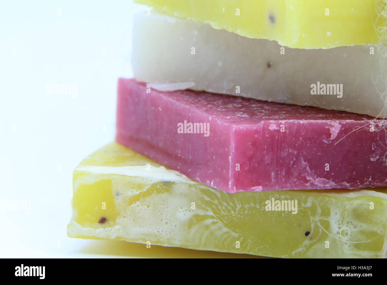 handmade soap, the bars of soap, colorful soap, white background, herbal soap, close up, macro shooting, lemon soap, - Stock Image
