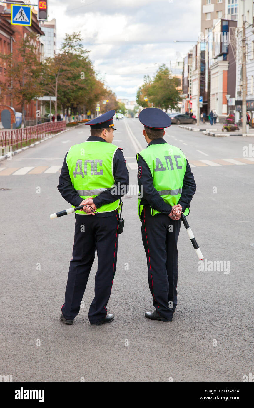 Russian police patrol officers of the State Automobile Inspectorate regulate traffic - Stock Image