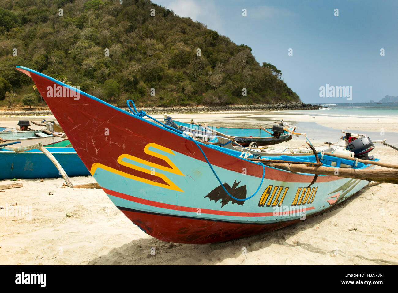 Indonesia, Lombok, Selong Blanak, beach colourfully painted fishing boat Gili Kedis with bat symbol - Stock Image
