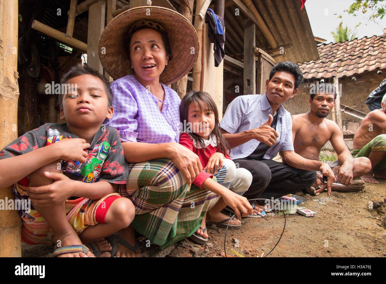 Indonesia, Lombok, Mantang, rural village community in family compound - Stock Image