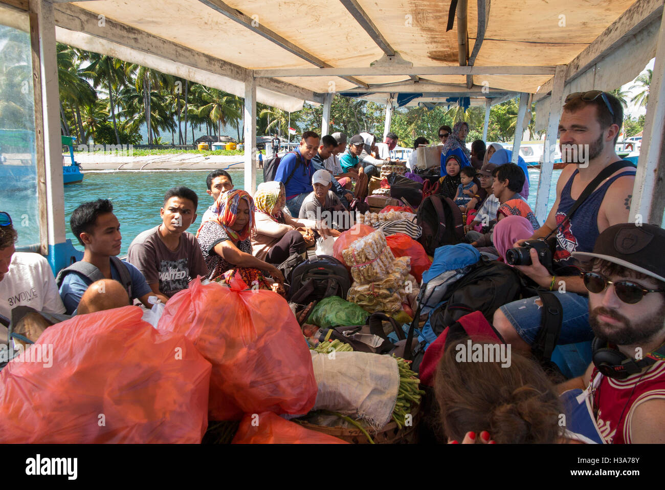 Indonesia, Lombok, Bangsal, passengers and cargo on public ferry to Gili Air - Stock Image
