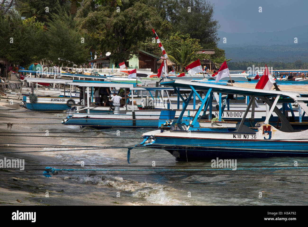 Indonesia, Lombok, Gili Air, public ferry boats to Bangsal moored at beach - Stock Image
