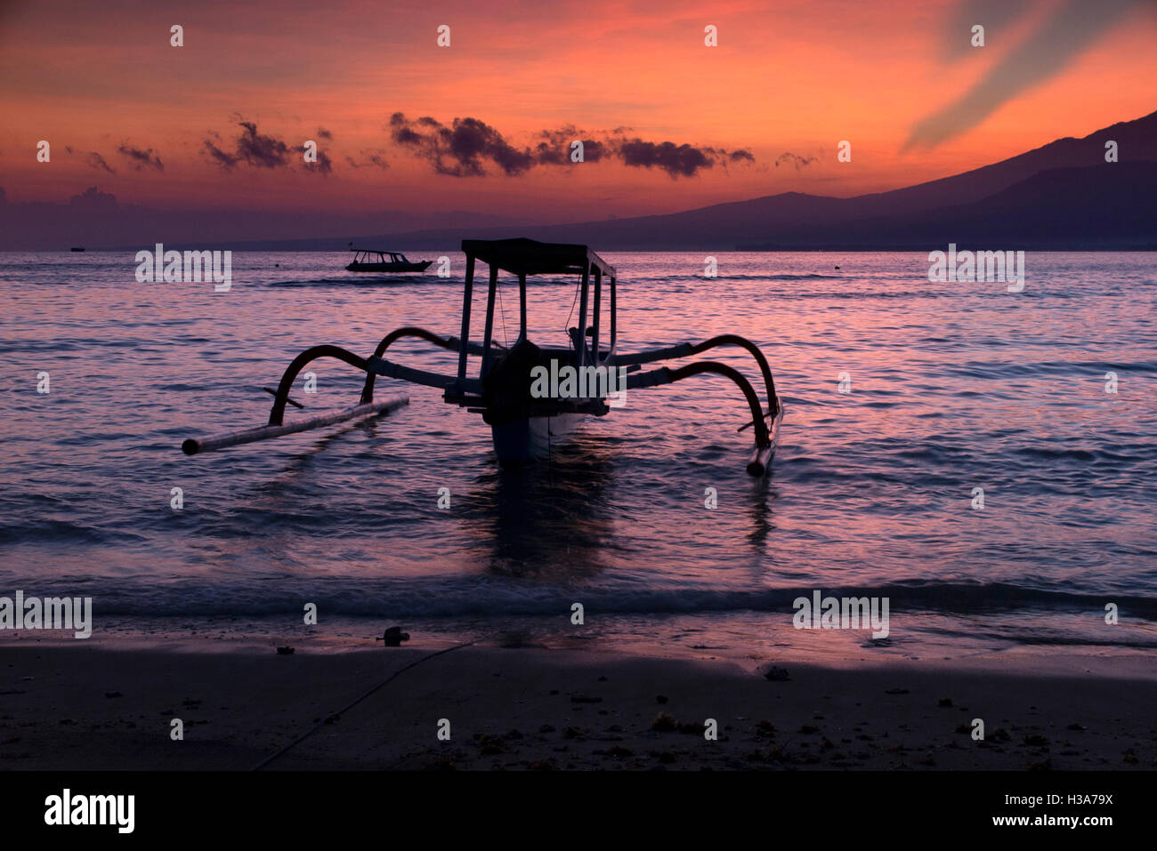 Indonesia, Lombok, Gili Air, sunrise over Guning Rinjani from west coast - Stock Image
