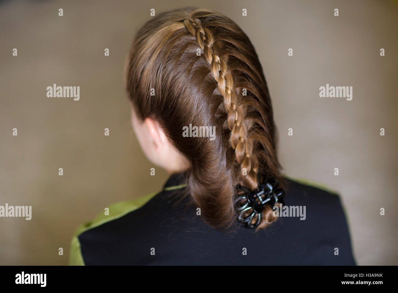 A Fancy Ribbon Braid On A Young Adult - Stock Image