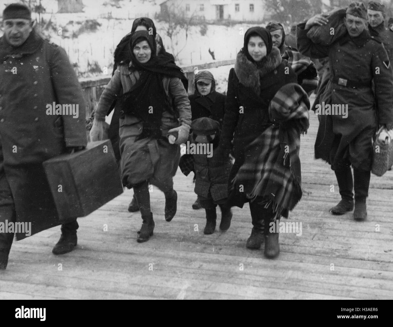 Soldiers help Volhynian Germans cross the Bug, 1939 - Stock Image