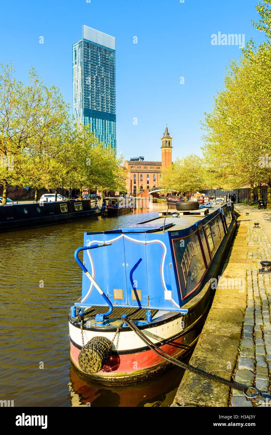 Narrowboat on the Bridgewater Canal Castlefield Manchester with the Beetham Tower on the skyline - Stock Image