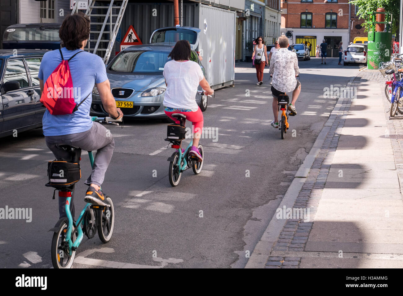 Tourists with fold able bicycles exploring the city - Stock Image