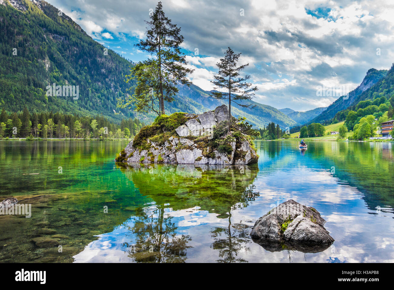 Beautiful scene of trees on a rock island in idyllic scenery at charming Lake Hintersee, Nationalpark Berchtesgadener - Stock Image