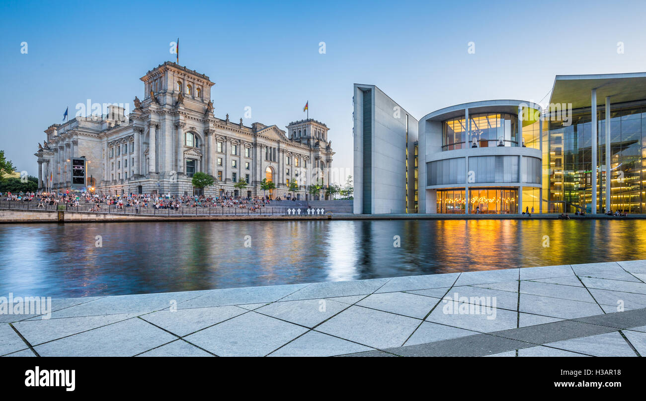 Classic view of modern Berlin government district with famous Reichstag building and Paul Lobe Haus in twilight, Stock Photo