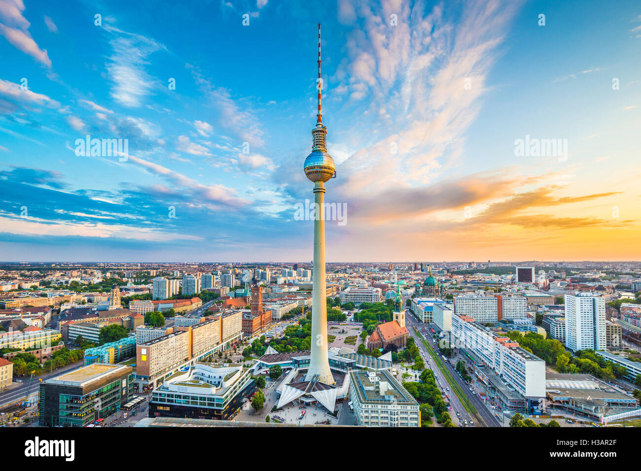 Berlin skyline panorama with famous TV tower at Alexanderplatz and dramatic clouds at sunset, Germany - Stock Image