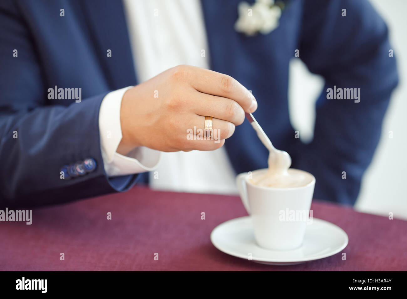 Man's hands and cup of coffee - Stock Image