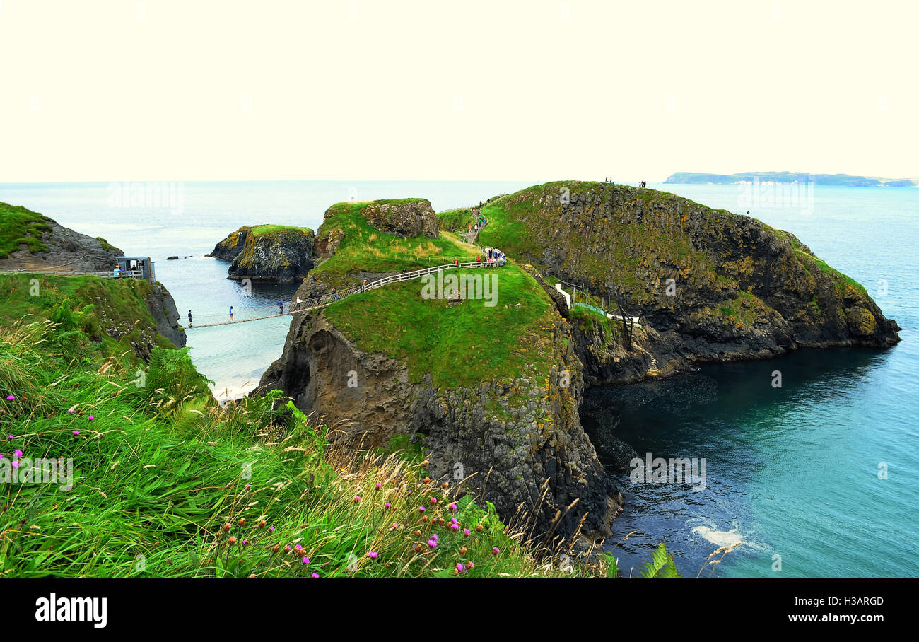 Carrick-a-Rede Rope Bridge is a famous rope bridge near Ballintoy in County Antrim, Northern Ireland. - Stock Image
