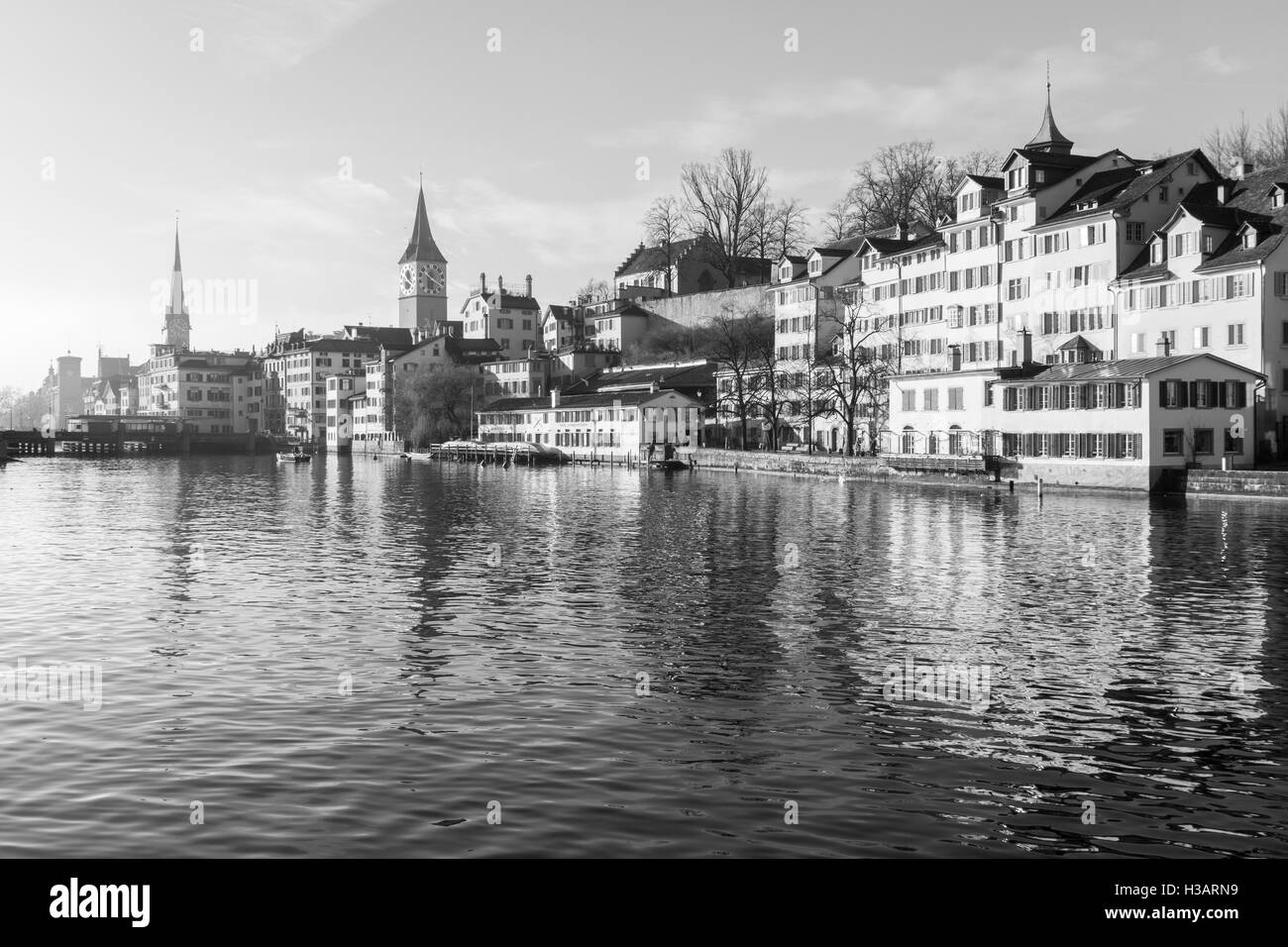 ZURICH, SWITZERLAND - DECEMBER 27, 2015: View of the west bank of the Limmat River, with the St. Peter and Fraumunster - Stock Image