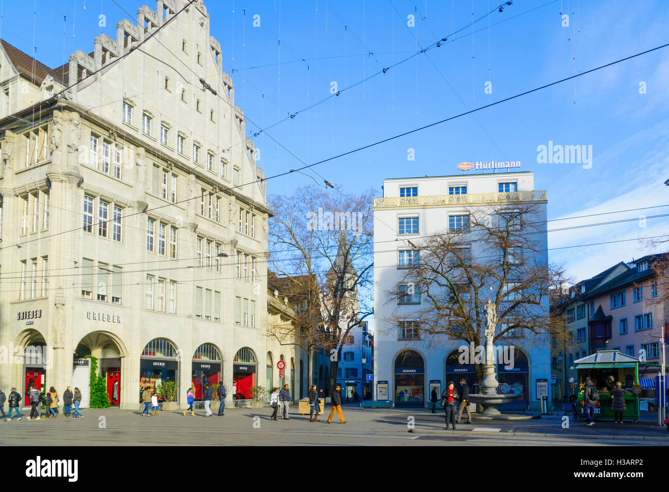 ZURICH, SWITZERLAND - DECEMBER 27, 2015: Scene of the Paradeplatz (Parade) square, with locals and visitors, in - Stock Image