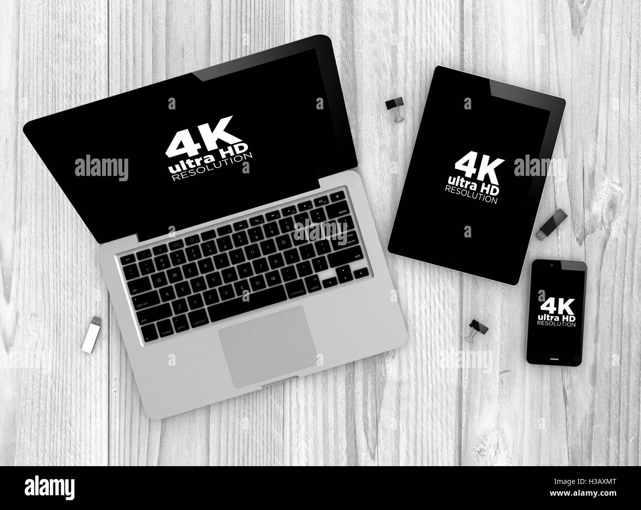 Technology concept: Devices witn 4k Ultra HD resolutions screens. All graphics are made up. - Stock Image