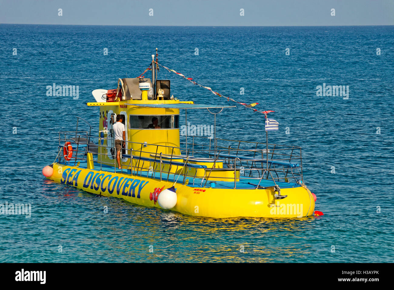 Tourism submarine and glass-bottom boat  at Rhodes,town, Island of Rhodes, Greece. - Stock Image