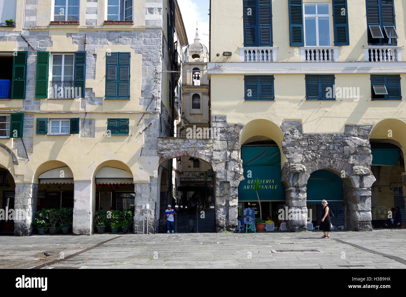 Genoa Italy, Alley between ancient arcaded palaces - Stock Image