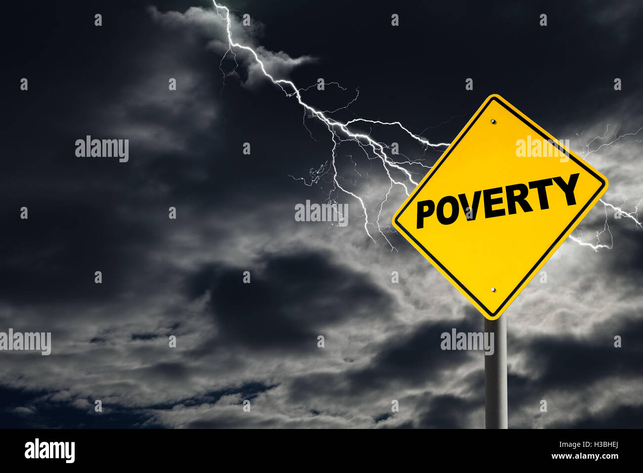 Poverty warning sign against a dark, cloudy and thunderous sky. Concept of poverty without solutions. - Stock Image