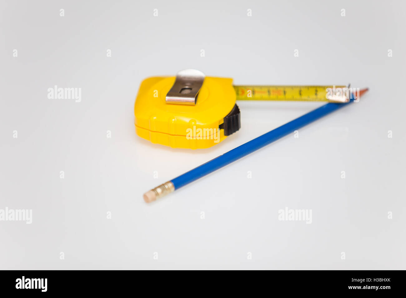 Meter stick and pencil / background - Stock Image