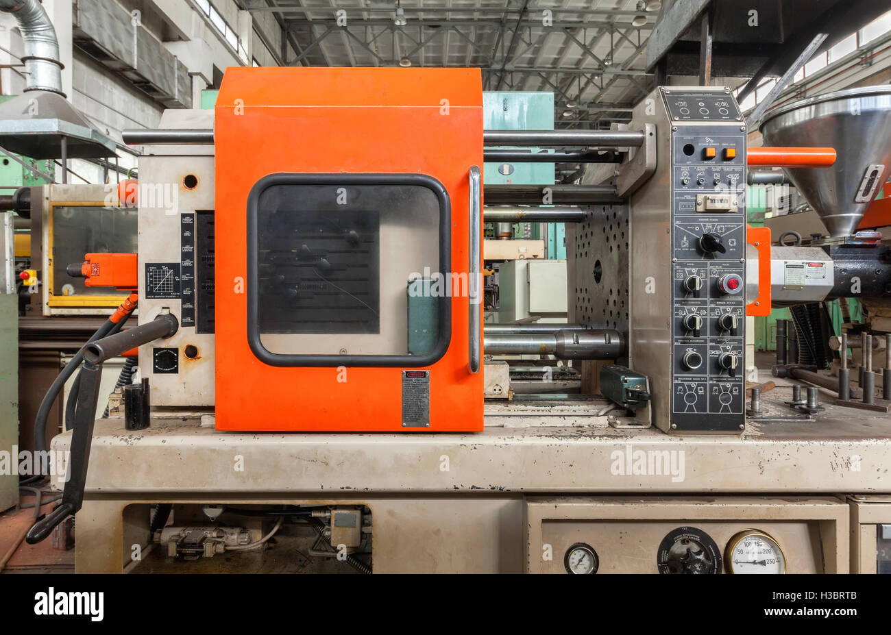 Injection molding thermoplastic machine close up - Stock Image