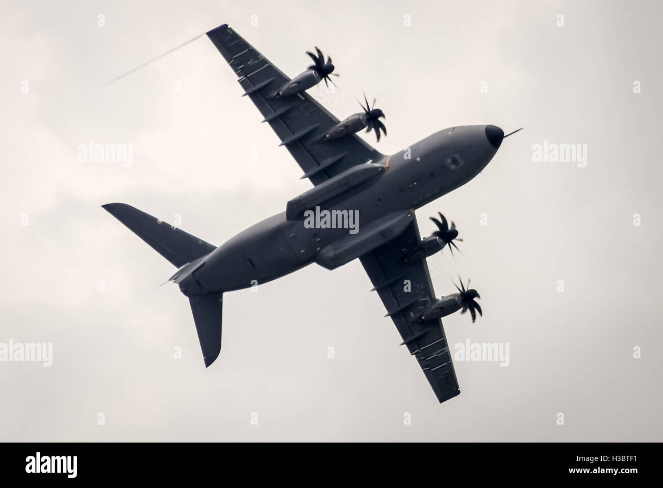 An Airbus A400M Atlas military transport aircraft performs at the Farnborough Air Show 2014. - Stock Image