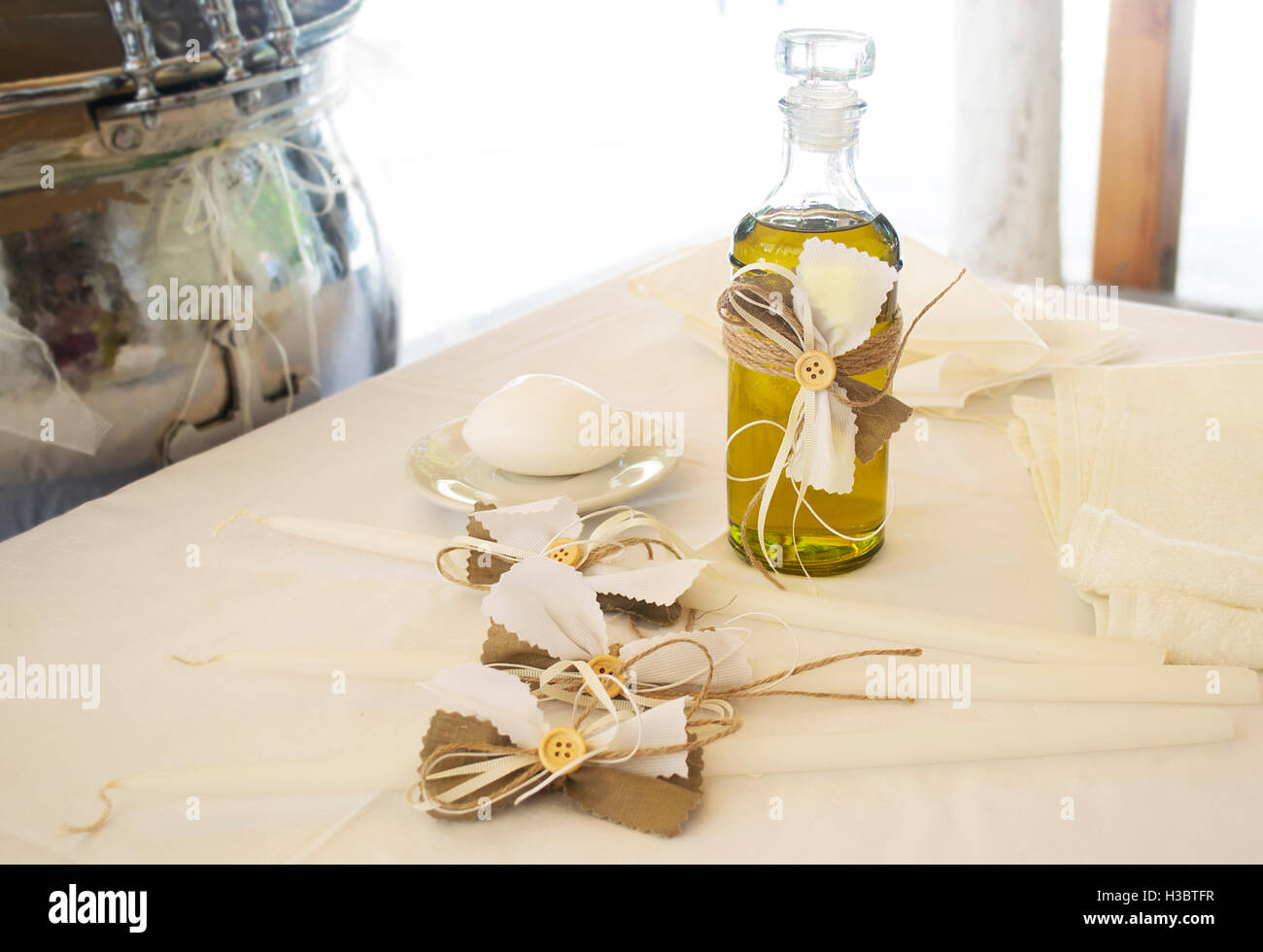 Orthodox Christening oil with candles and soap - Stock Image