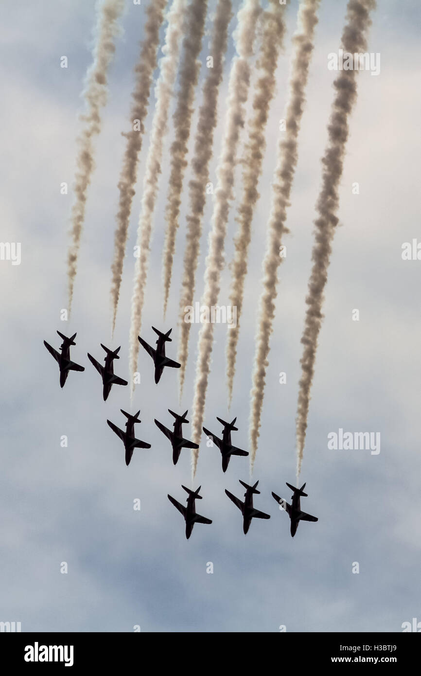 The Red Arrows perform aerobatic at Farnborough Air Show - Stock Image
