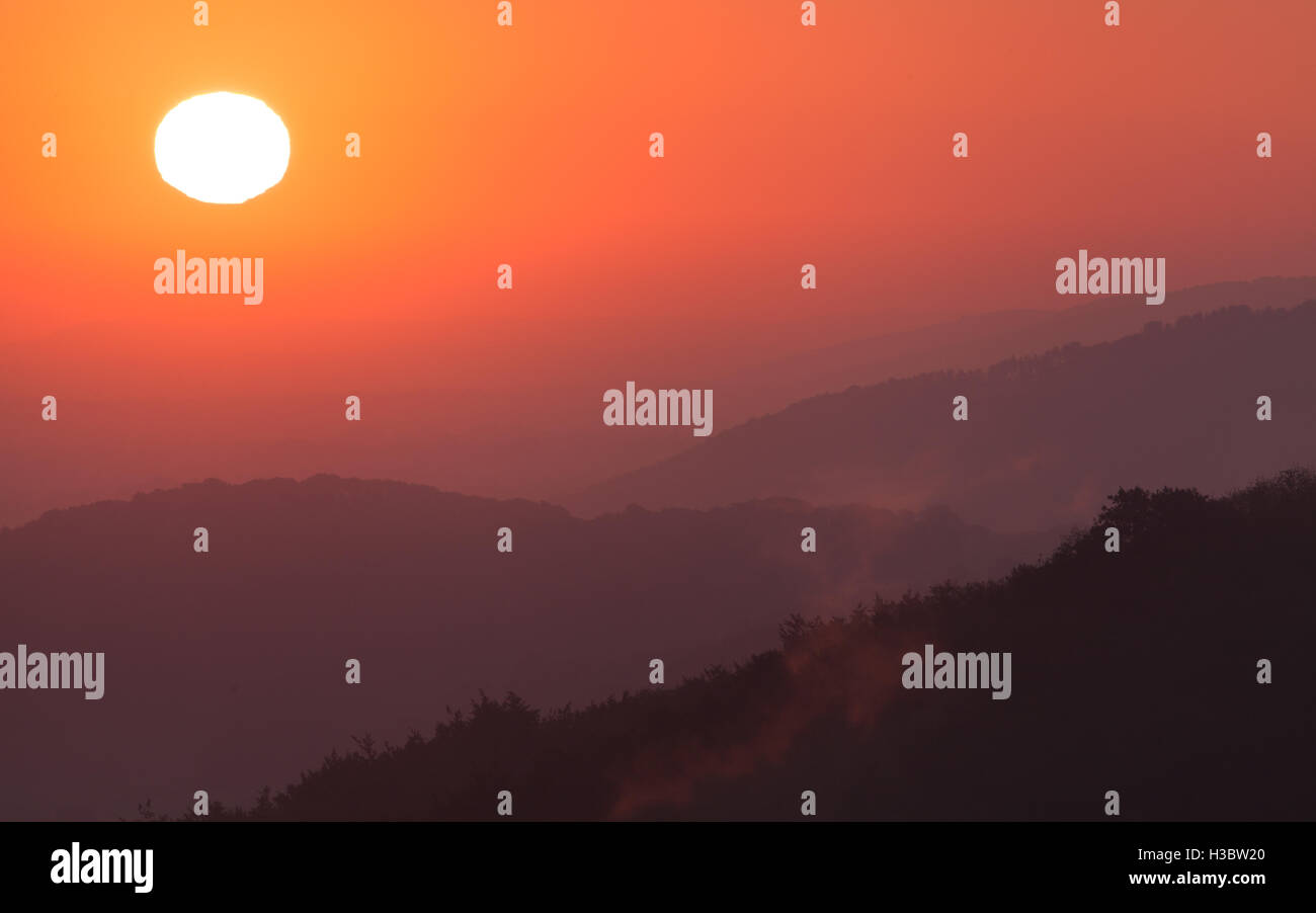 Dawn breaks as the sun is seen rising over the South Downs National Park - Stock Image