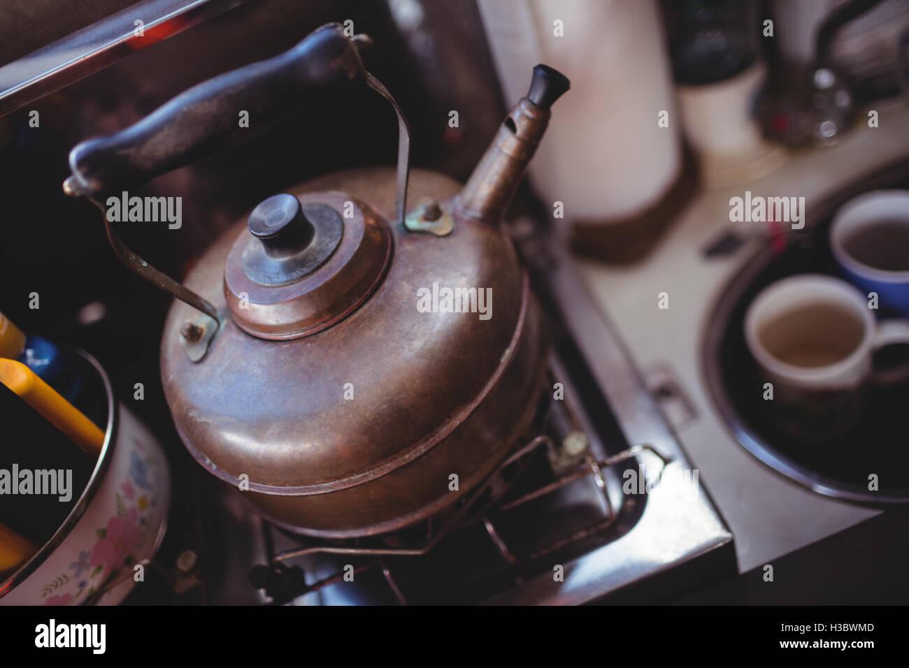 Tea kettle on gas stove Stock Photo