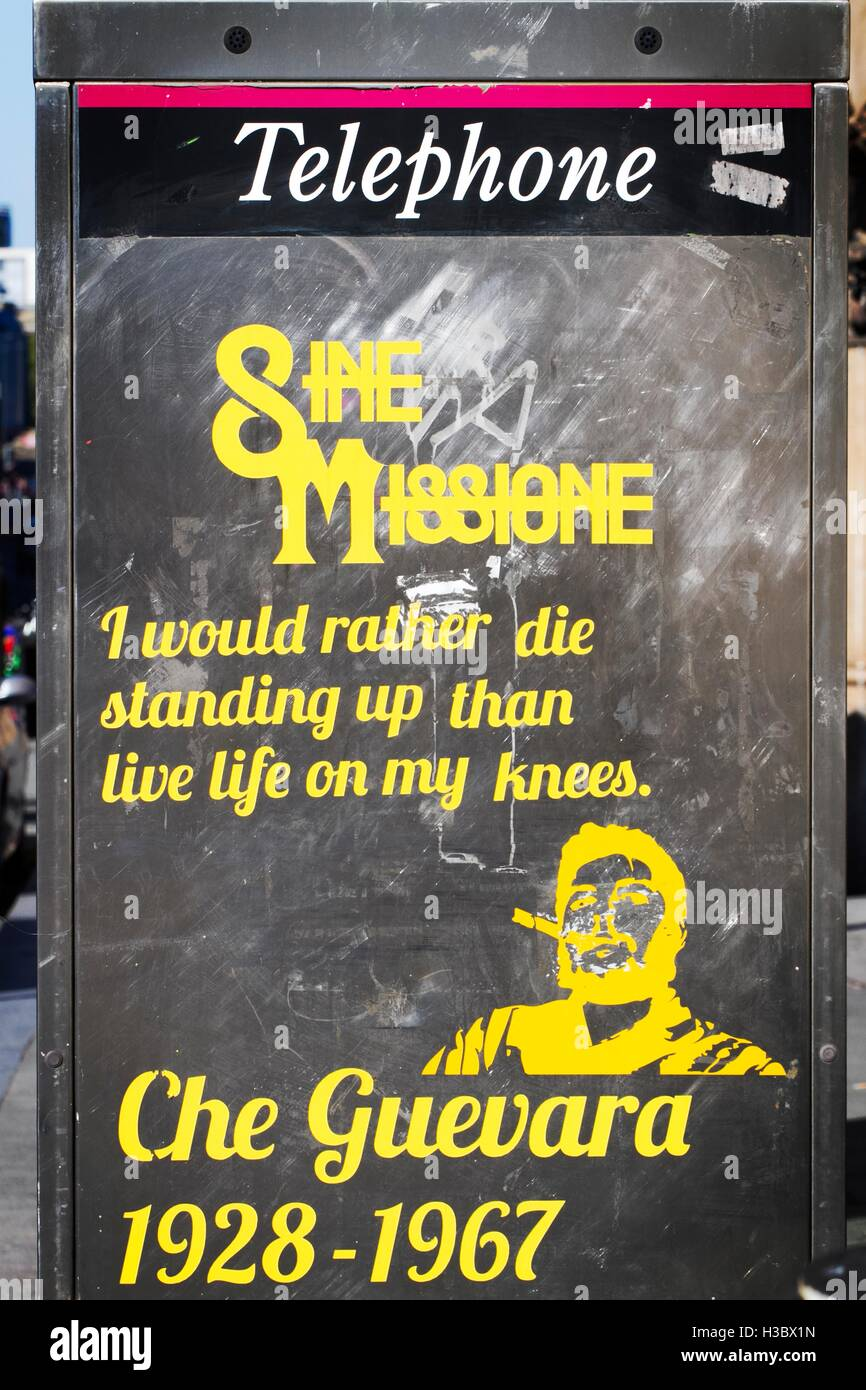 A stencilled quotation of Che Guevara on BT telephone kiosk in Liverpool, Merseyside, UK - Stock Image