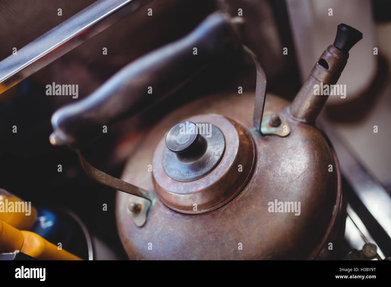 Tea kettle on gas stove - Stock Image