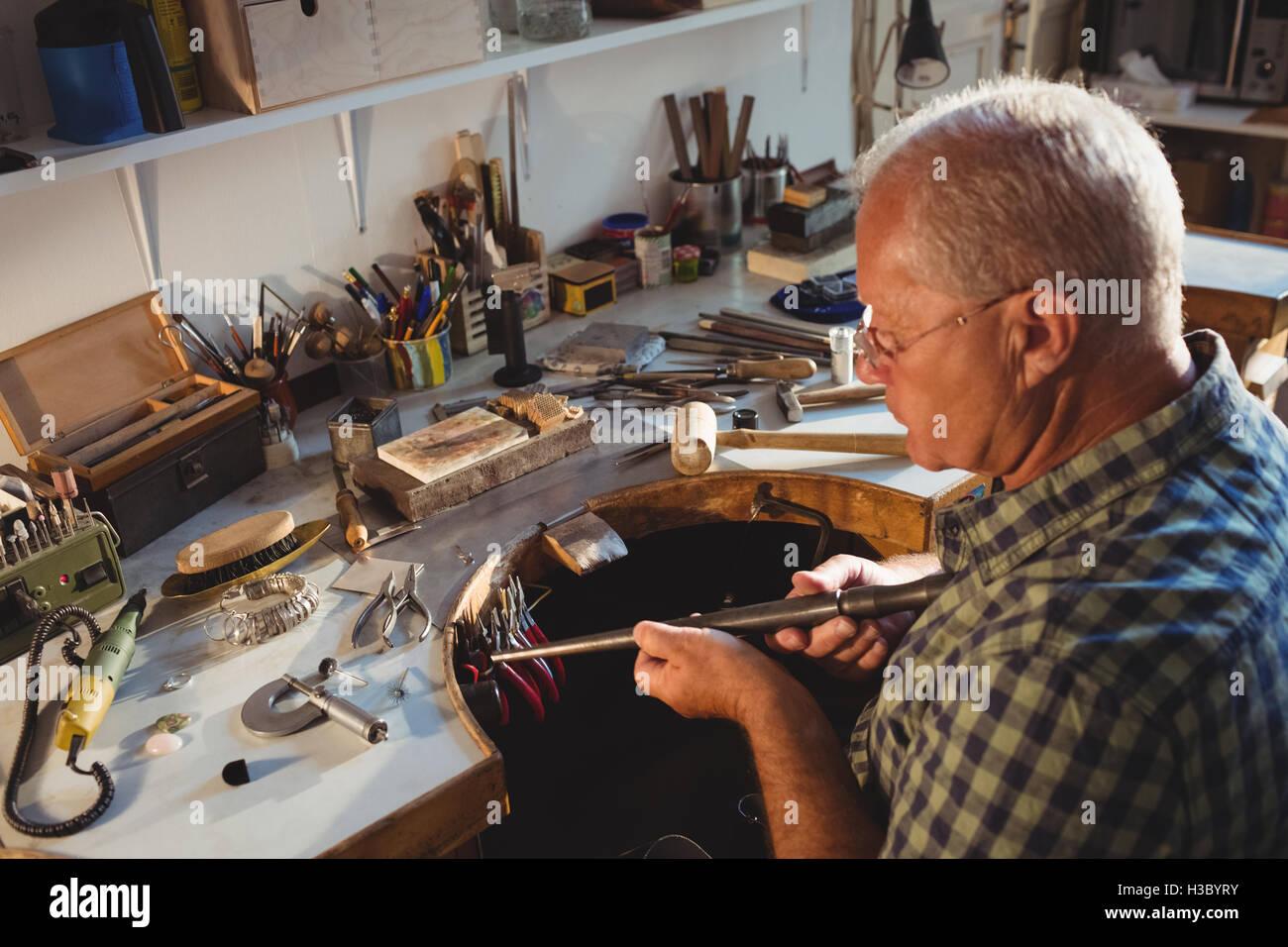 Goldsmith preparing work tool - Stock Image