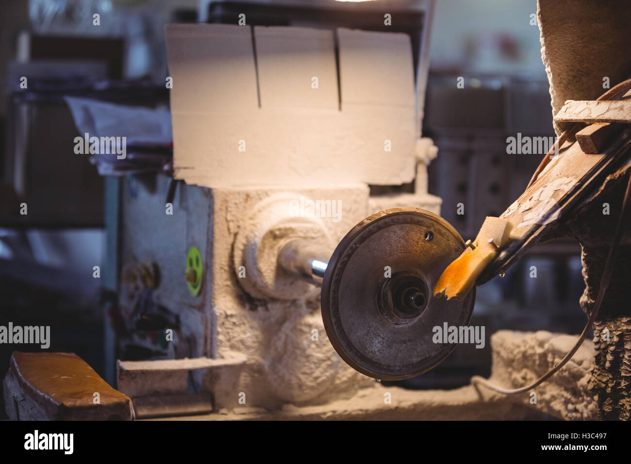 Glass shaping machine in glass blowing factory - Stock Image