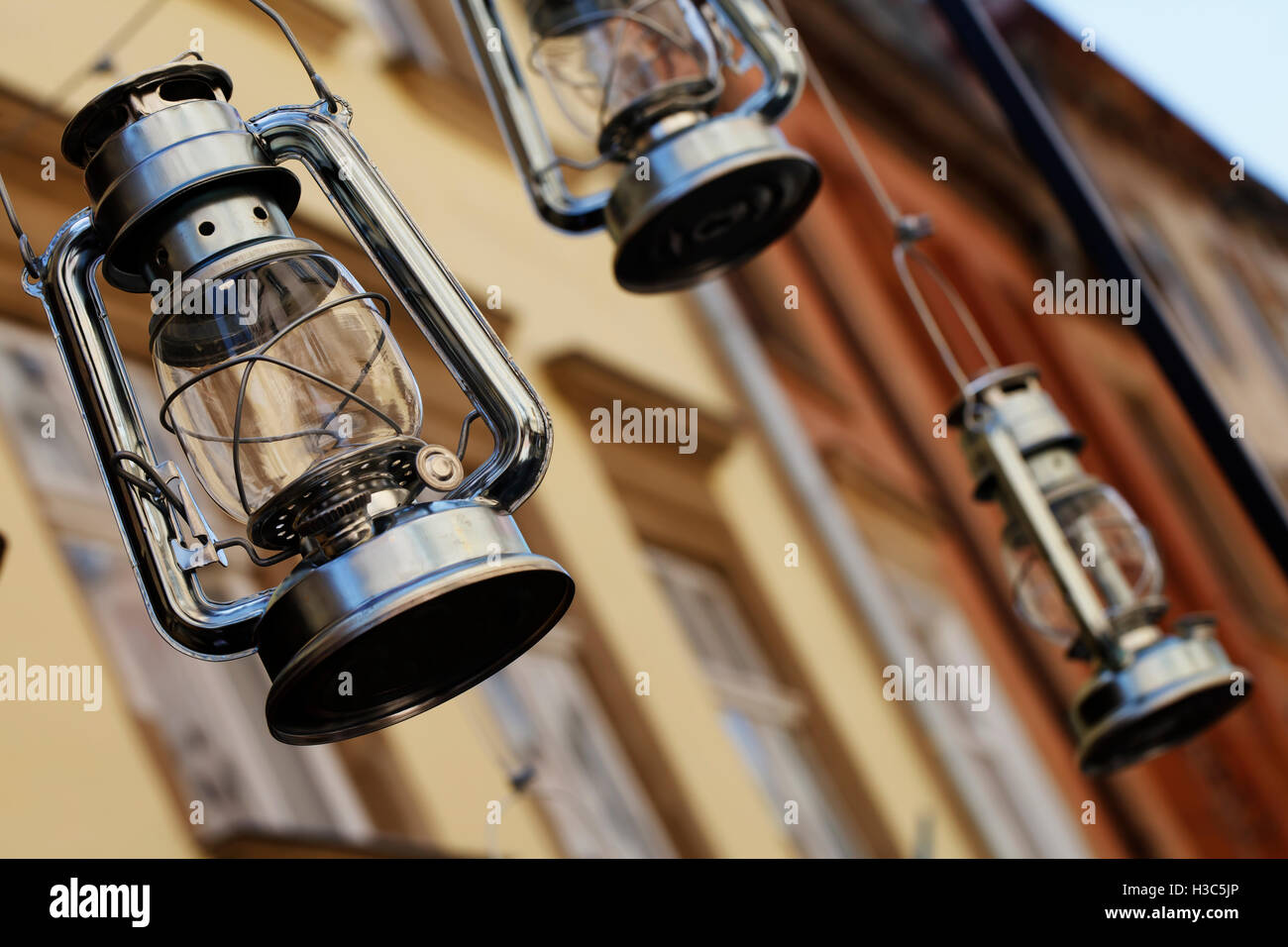 a Vintage kerosene lamp, retro lighting background - Stock Image